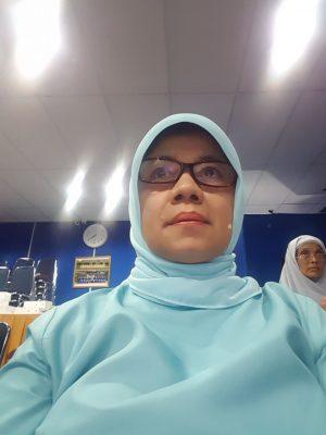 Asneli  Ahmad, S.Pd.